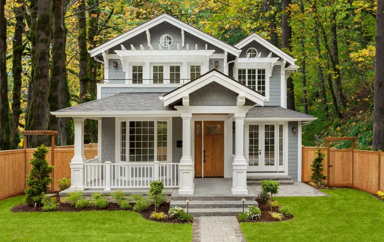 new luxury home with elegant touches including covered entrance, and columns