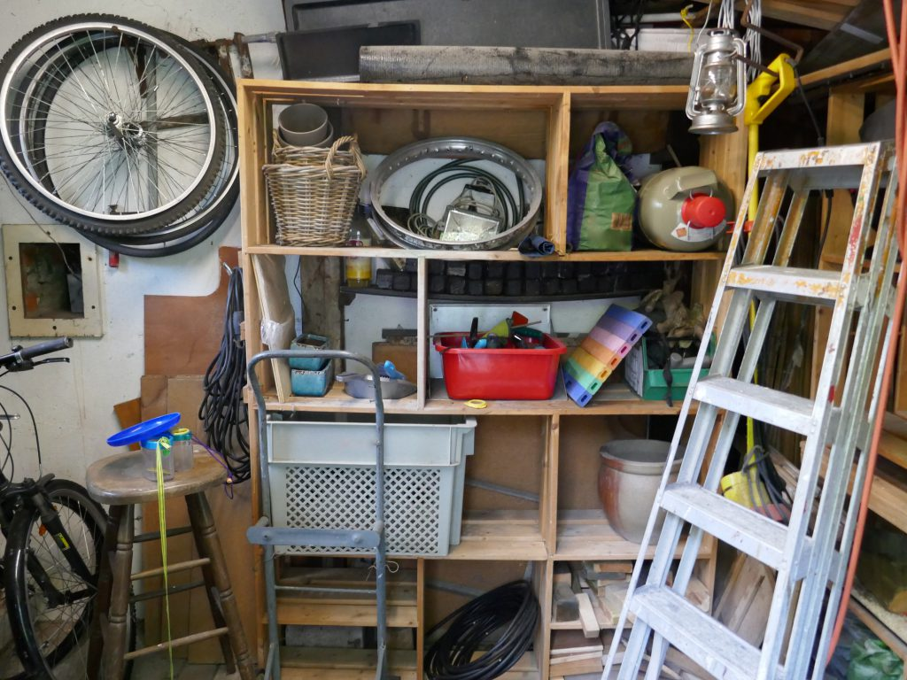 Hand tools and many different items of a handyman in a garage
